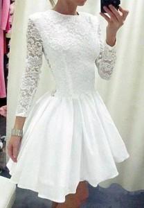 Biała, koronkowa sukienka.